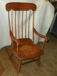 vintage wooden rocking chair lions head can anyone identify this mission
