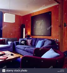 Red And Blue Living Room Large Abstract Painting On Wall Above Blue Sofa In Terracotta Red
