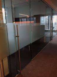 image of pureglass sliding door hardware in office