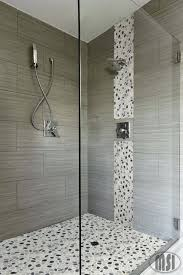 glass pebble tile mosaic pebble beach mosaic tile pebble beach glass mosaic tile love the pebble glass waterfall vertical design and the matching shower