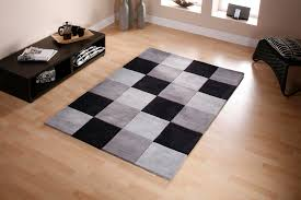 small modern black and white checd rug in a square shape