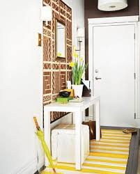 There's bitter irony in the fact that designated entryway space is  especially important in very small homes that lack any entryway at all.