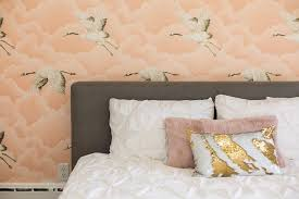 gray headboard with pink and gold pillows