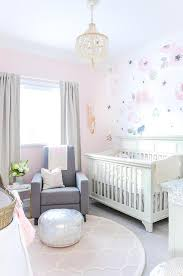 round pink trellis nursery rug with gray glider