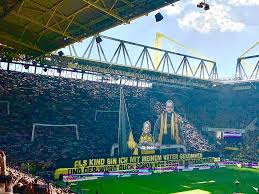 When borussia dortmund hosted eintracht frankfurt on friday, the yellow wall paid tribute to the landmarks of the city of dortmund, reading big city, my dream while depicting the city's landmarks and crest. Dortmund Signal Iduna Park 1024x768 Wallpaper Teahub Io