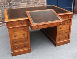 georgian gany leather top partners desk with three drawers on the a the central