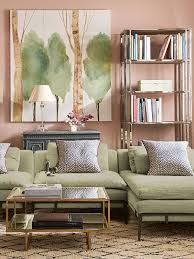 green sofa living room. palest pink/peach wall for green sofa. everything about this informal sitting room is calming - from the gentle colour palette of pale green and pink, sofa living n