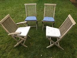 four teak folding garden chairs with cushions