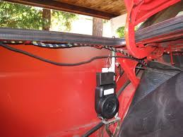 once you are sure that you have the right harness you can continue first zip tie the module securely under the power antenna housing