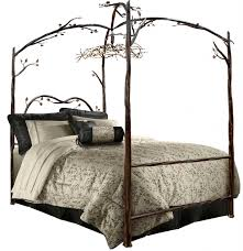 brown brushed wrought iron tree canopy bed using black pillowcase and bolster also leaves pattern bed bedroom endearing rod iron