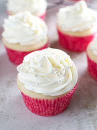 Almond Cupcakes With Whipped Almond Buttercream Frosting Stuck On