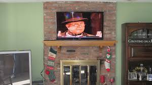 are you interested in mounting tv above fireplace. Furniture Beautifull Mounted Tv Above Bricks Fireplace Bined With Mounting Brick Are You Interested In E