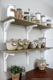 open shelving pantry wood shelves glass containers make this pantry beautiful a dresser