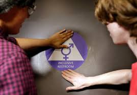 school bathroom laws. destin cramer, left, and noah rice placing a sign on the door of bathroom that was designated as gender neutral last week at nathan hale high school in laws f