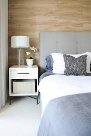 stylish bedroom design of false creek condo design decorated with small white cabinet and chic table chic small white home