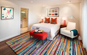 wayfair com rugs with traditional bedroom also colorful colorful artwork colorful rug comfort en suite guest room orange lamp red bench retreat striped area