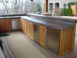 Outdoor Kitchen Cabinet Doors Built In Bbq Smooth Stucco Face And A Colored Concrete Countertop