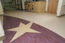 hospital sheet vinyl install graphics heat welding corridors capozza tile flooring center