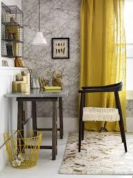 dark wood for furniture. marbleeffect wallpaper creates a striking focal point yellow linen curtains cast rich dark wood for furniture