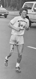 terry fox  a young man short curly hair and an artificial right leg runs down a