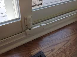 a patio door with security kick lock