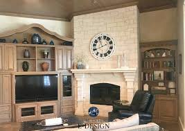 large clock on limestone fireplace with