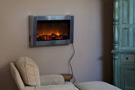 well traveled living stainless steel wall mounted electric fireplace com