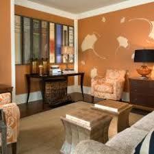 burnt orange and brown living room. Burnt Orange Living Room With Book Binding Art And Brown