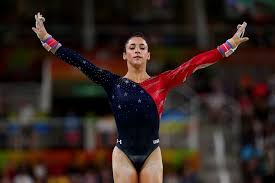 aly raisman peting on the uneven bars at the rio olympic games august 7