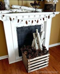 birch logs fireplace birch log pine cones at the fireplace decorating the fireplace for winter faux