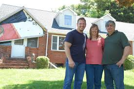 most desperate landscape on the diy network poses with homeowners patty and casimir stochmal of derby the stochmals won a front yard makeover worth