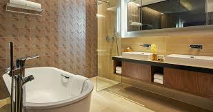 oasia hotel downtown singapore club suite bathtub 1 2