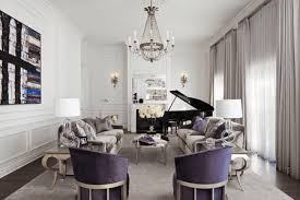 elegant living room with chandelier and sconces