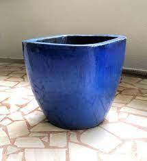 glazed ceramic blue pot moving