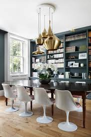 tulip chairs and tom dixon brass ceiling lamps for dining room