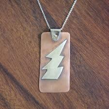 sterling silver lightning bolt on copper pendant