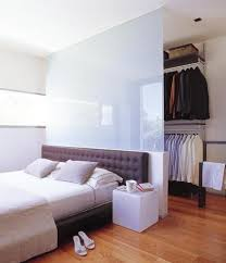 small bedroom spaces. glass room dividers to create storage space in small bedroom spaces