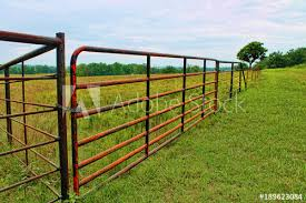Metal farm fence Cheap Red Metal Farm Fence Across Green Pasture Dingzhou Huaxin Metal Products Co Ltd Global Sources Red Metal Farm Fence Across Green Pasture Buy This Stock Photo