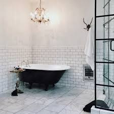 french bathroom design with black claw foot tub