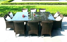 outdoor dining table glass top garden tubular aluminium round with amazing of outdo