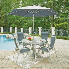 home styles furniture south beach 7 piece round outdoor dining table and 4 chairs with umbrella and base