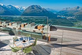 architecture outdoor pool and patio design in the switzerland hotel with wooden floor glass railings
