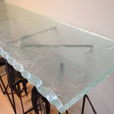 glass table top texture. our thick ultra clear glass with hand-crafted creekside texture and a hand-barked edge top one-of-a-kind metal horse-themed table base in home