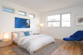 rug under bed hardwood floor. Blue Lounge Chairs For Bedroom Mixed With Small Ottoman And Varnished Hardwood Floor Under Light Grey Rug White Bulb Lamp Bed O