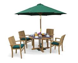 canfield round 1 2m table 4 bali stacking chairs teak patio