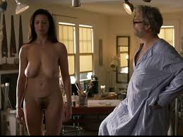 Mimi Rogers exposing her huge tits and hairy pussy in nude movie.