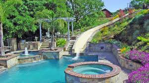Contemporary Pool Designs With Slides And Waterfalls Intended Inspiration Decorating