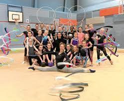 beacon rhythmic gymnastics club members with coach laura ytre eide and front former olympian elizabeth paisieva