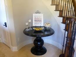 wonderful black polished rounded pedestal entryway table with gl
