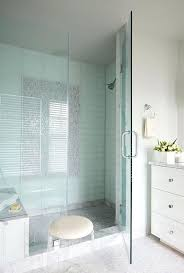 glass tile in shower mosaic marble tiles lead to a walk in shower clad in blue glass tile in shower